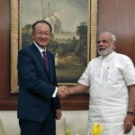 World Bank President Jim Young Kim and India's Prime Minister Narendra Modi shake hands before their meeting in New Delhi