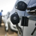 Keys hang from door of Maruti Suzuki Swift car at its stockyard on the outskirts of the western Indian city of Ahmedabad